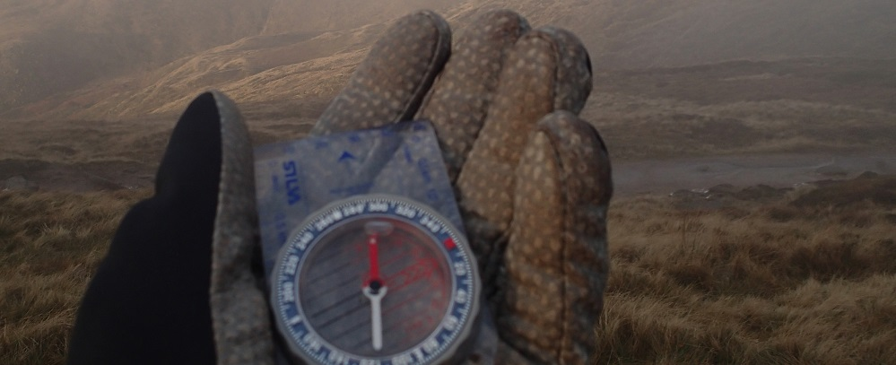 Compass and gloves - basic outdoor gear