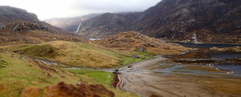 Climbing Aird da Loch peninsula on the Cape Wrath Trail on the way to Glendhu